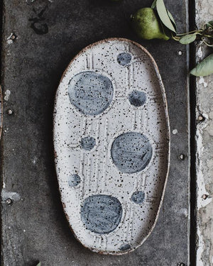 spot plate hand made with gritty clay body crafted by clay beehive