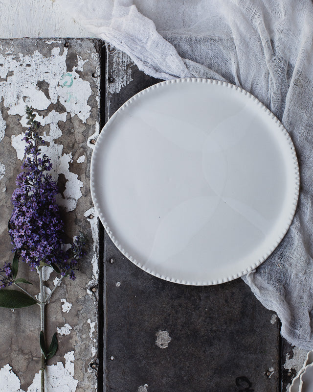 satin white plate handmade with detailed texured rim from clay beehive ceramics