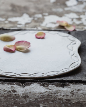 satin white platter plate hand made with a carved rim by clay beehive ceramics
