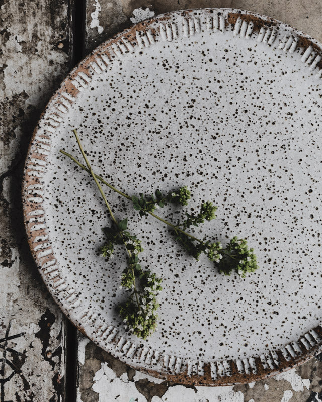 Rustic earthy speckled carved plates