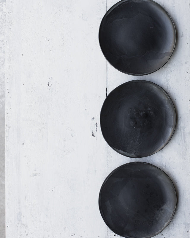 black matte plates by clay beehive ceramics