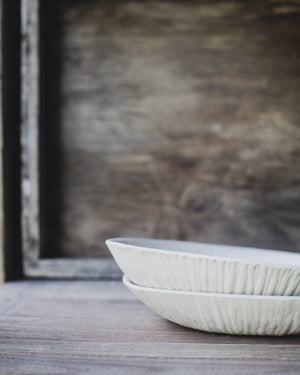 textured bowls with wide and shallow design hand made by clay beehive ceramics