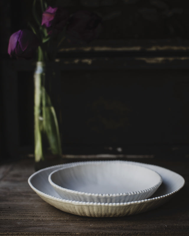 Satin white bowls with textured rim and elegant design by clay beehive ceramics
