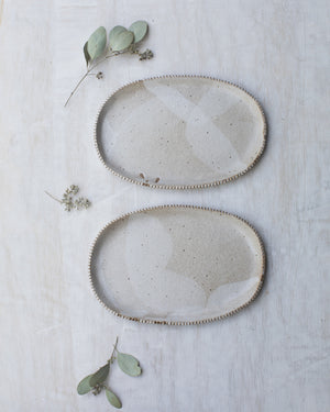 Cafe au Lait Oval plates with warmy toasty tones and textured edging