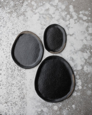 sharing plates black glaze over stoneware clay body by clay beehive ceramics