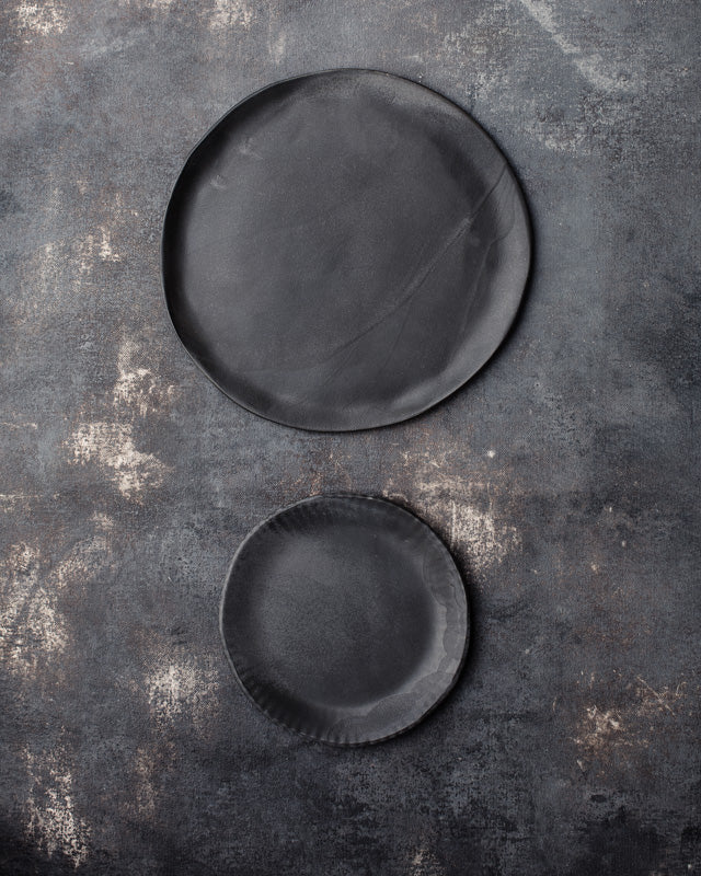 Satin black plates with a flash of charcoal