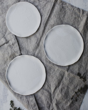 satin white plates with a lovely textured surface created by clay beehive ceramics