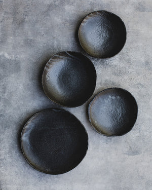 black stoneware footed bowl handmade by clay beehive ceramics