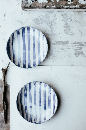 Blue and white striped low and wide bowls