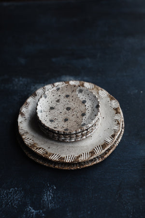 rustic gritty plate with detailed edge by clay beehive