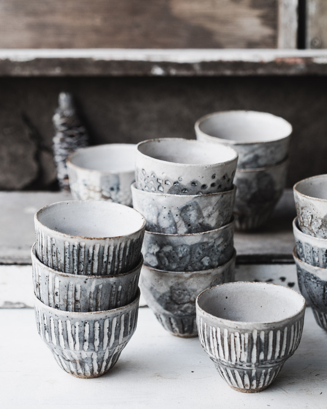 Carved rustic handmade yunomi style cups with grey/white glazing by clay beehive ceramics