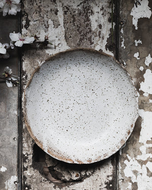 Rustic gritty low and wide ceramic white bowl handmade by clay beehive