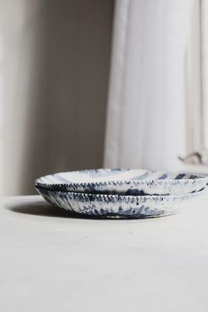 coastal inspired blue and white striped bowls by clay beehive