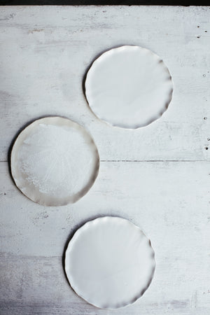 Satin white cake plates with an elegant rim
