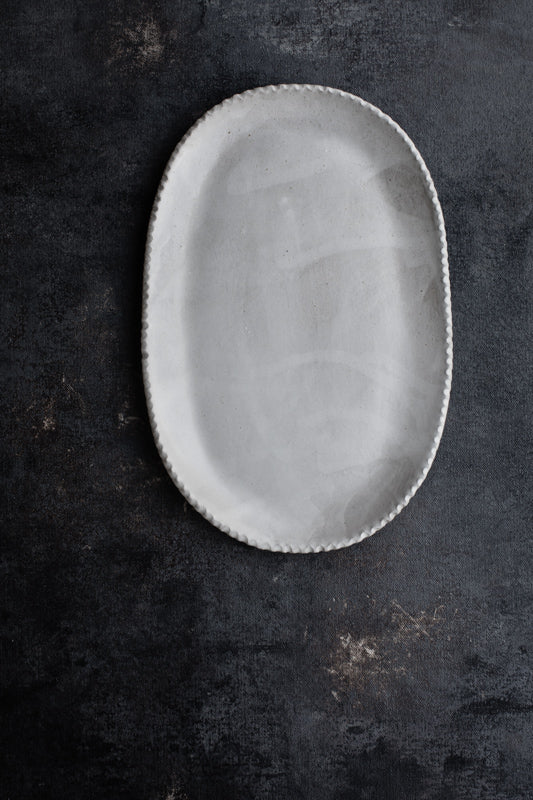 oval plate with satin white glaze by clay beehive ceramics