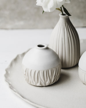 Satin white wheel thrown bud vases with carving details by clay beehive ceramics