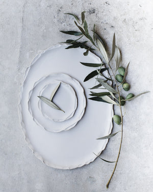 Pretty oval shaped white handmade platter with delicate pretty edging by clay beehive ceramics