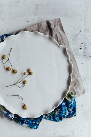 Petal white satin plate by clay beehive