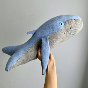 Blue and gray stuffed animal whale