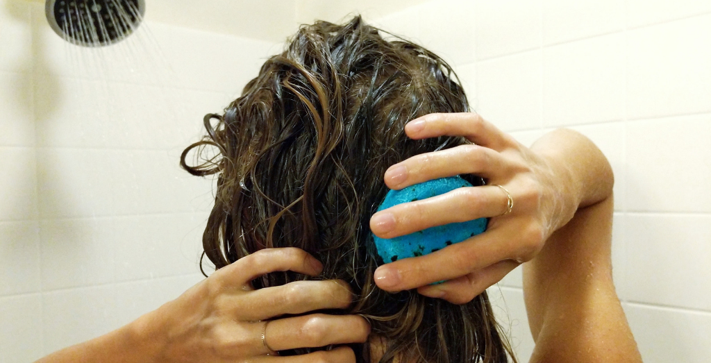 Girl washing hair with shampoo bar