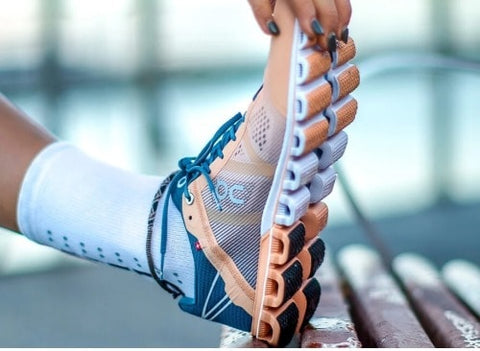 Women Stretching with On Running Shoes on