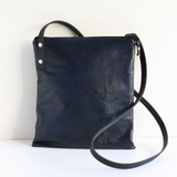 Navy leather and canvas cross body bag