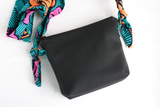 Black vegan leather cross body bag with Ankara fabric strap