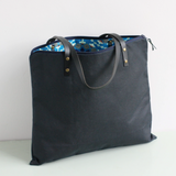 Navy waxed canvas tote with a blue Ankara lining