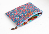 Floral makeup bag with 'LOVE' tag