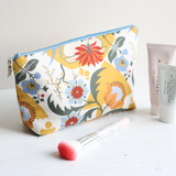 Blue and yellow toiletry bag with wipe clean lining