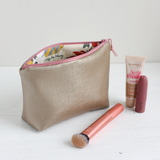 Gold vegan leather makeup bag