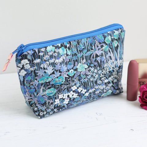 Blue floral fabric makeup bag