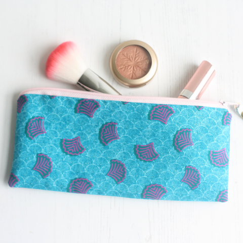 Turquoise Ankara fabric makeup bag from A Bag Less Ordinary