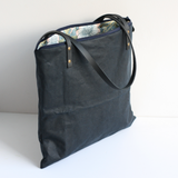 Navy waxed canvas tote with a William Morris print lining