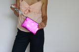 Pink metallic leather clutch
