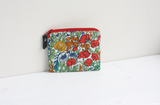 Red floral Liberty fabric purse with Ankara lining