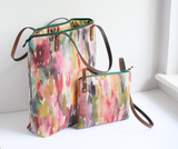 Colourful fabric cross body bag with leather strap