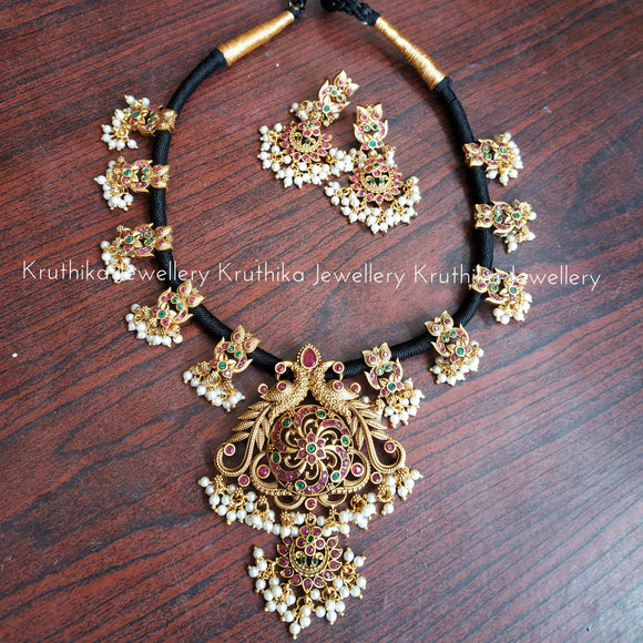 Black Thread peacock necklace
