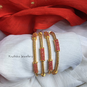 Gold finish Ruby bangles B10