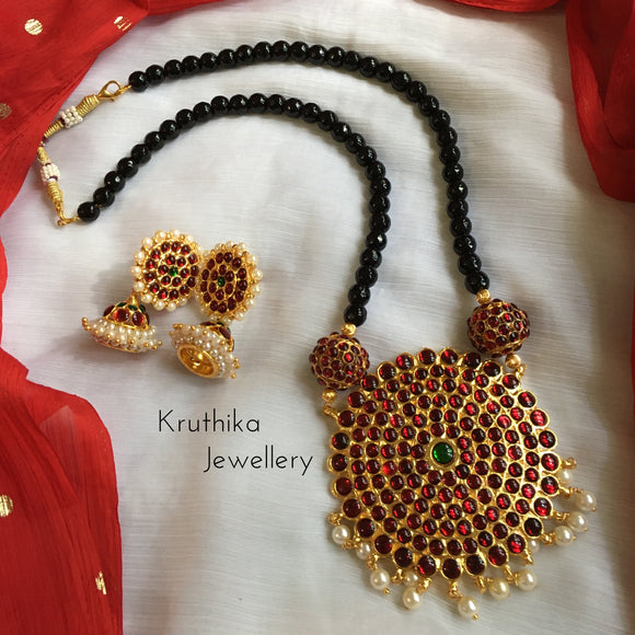 Black beads maala with big kemp surya pendant