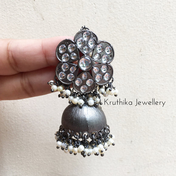 Black polish brass metal jhumkas with pearl earchains