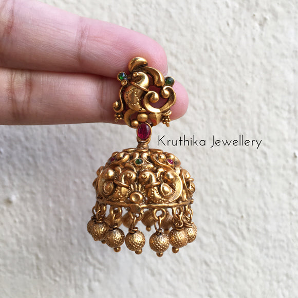 Intricate peacock Jhumkas