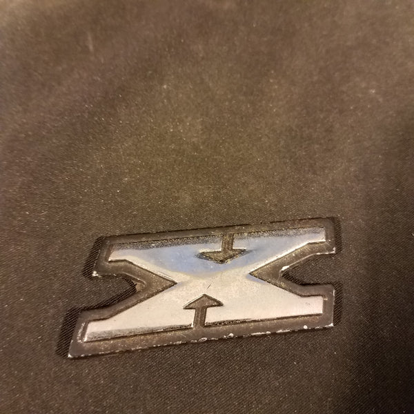 AMC badge emblem X letter
