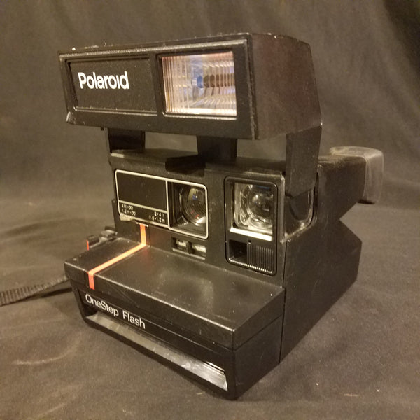 Polaroid one-step flash film camera