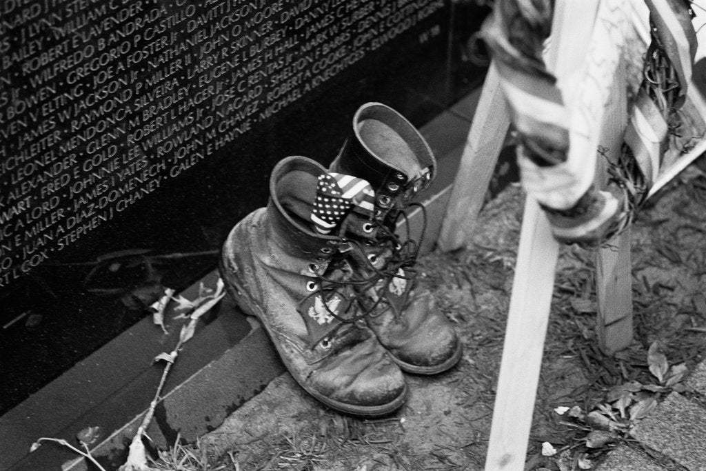 Detail of Combat boots at the Vietnam Veterans Memorial by Michael Katakis