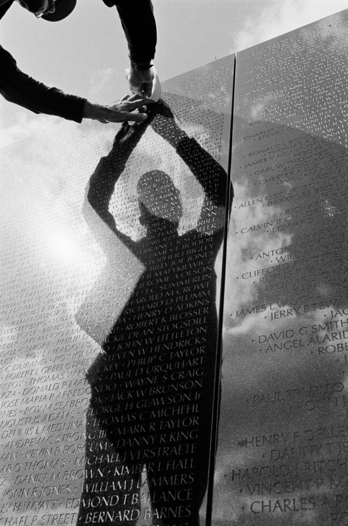 Detail of Reflection of a volunteer at the Vietnam Veterans Memorial by Michael Katakis
