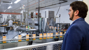 Alfa Vitamins CEO watches production in his manifacture