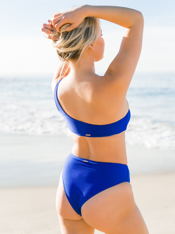 BEACH PLEASE ASYM RIB SWIM TOP