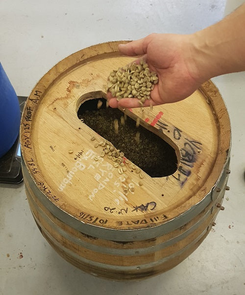 arabica coffee beans aged in a bourbon barrel for 30 days