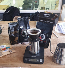 experimenting with cannonball coffee, deathwish coffee and black rifle. brewing pour-over coffee with measuring scales